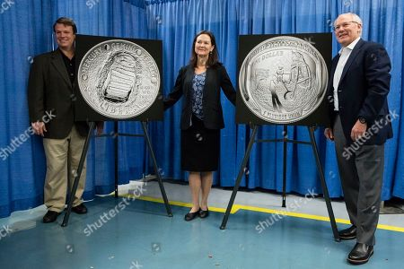 Mark Armstrong, Ann Starr, Andrew Aldrin. The children of Apollo 11 crew members, Neil Armstrong's son Mark Armstrong, left, Mike Collins' daughter Ann Starr, and Buzz Aldrin's son Andrew Aldrin, pose for photographs with enlargements of the 2019 Apollo 11 50th Anniversary Proof Silver Dollar during a ceremonial strike ceremony at the United States Mint in Philadelphia, . The coin commemorates the 50th anniversary of the first manned moon landing and is expected to be available to the public in January of 2019