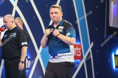 Martin Schindler wins a set and celebrates during the PDC World Championship Darts at Alexandra Palace, London