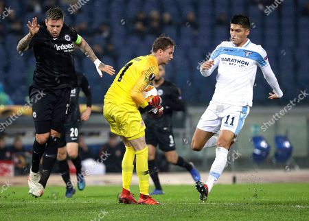 Frankfurt goalkeeper Frederik Ronnow, center, saves a ball during a Europa League, Group H soccer match between Lazio and Eintracht Frankfurt at Rome's Olympic stadium, Thursday, Dec.13, 2018