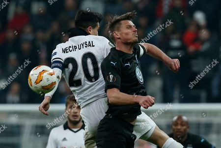 Malmo's Markus Rosenberg, right, jumps for a header with Besiktas midfielder Necip Uysal during the Europa League, Group I, soccer match between Besiktas and Malmo FF at the Besiktas Park stadium, in Istanbul