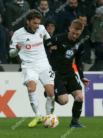 Malmo's Anders Christiansen, right, challenges for the ball with Besiktas midfielder Adem Ljajic during the Europa League, Group I, soccer match between Besiktas and Malmo FF at the Besiktas Park stadium, in Istanbul