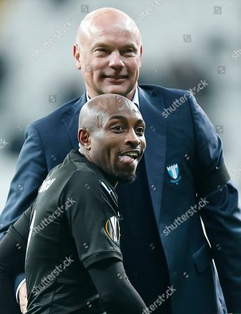 Malmo's Fouad Bachirou, left, and Malmo head coach Uwe Rosler celebrate after the Europa League, Group I, soccer match between Besiktas and Malmo FF at the Besiktas Park stadium, in Istanbul