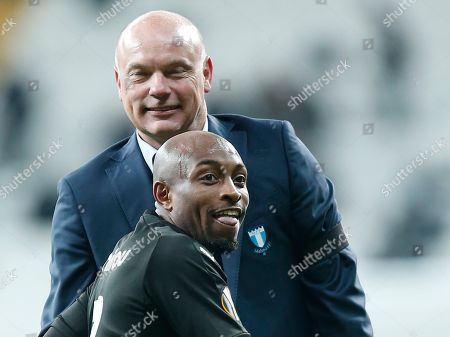 Malmo's Fouad Bachirou and head coach Uwe Rosler celebrate after the Europa League, Group I, soccer match between Besiktas and Malmo FF at the Besiktas Park stadium, in Istanbul