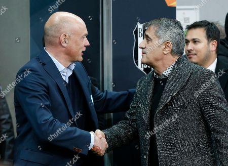 Besiktas coach Senol Gunes, right, shakes hands with Malmo head coach Uwe Rosler, before the Europa League, Group I, soccer match between Besiktas and Malmo FF at the Besiktas Park stadium, in Istanbul