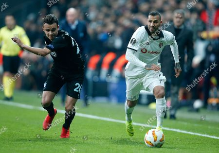 Stock Photo of Besiktas midfielder Ricardo Quaresma, right, challenges for the ball with Malmo's Andreas Vindheim during the Europa League, Group I, soccer match between Besiktas and Malmo FF at the Besiktas Park stadium, in Istanbul