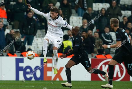 Besiktas midfielder Adem Ljajic, left, challenges for the ball with Malmo's Fouad Bachirou during the Europa League, Group I, soccer match between Besiktas and Malmo FF at the Besiktas Park stadium, in Istanbul