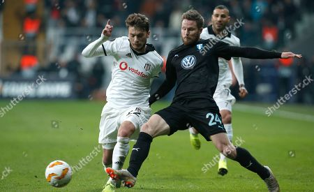 Malmo's Lasse Nielsen, right, challenges for the ball with Besiktas midfielder Adem Ljajic during the Europa League, Group I, soccer match between Besiktas and Malmo FF at the Besiktas Park stadium, in Istanbul