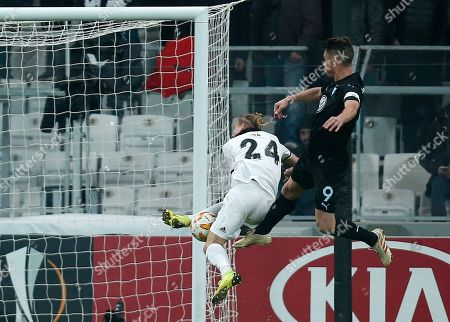 Malmo's Markus Rosenberg attempts to score next to Besiktas defender Domagoj Vida during the Europa League, Group I, soccer match between Besiktas and Malmo FF at the Besiktas Park stadium, in Istanbul