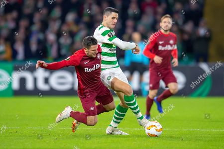 Tom Rogic (#18) of Celtic FC wins the ball from Zlatko Junuzovic (#16) of Red Bull Salzburg during the UEFA Europa League Group B match between Celtic FC and RB Salzburg at Celtic Park, Glasgow