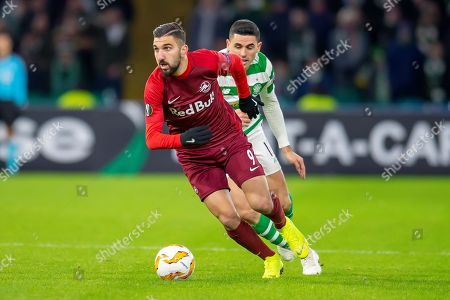 Munas Dabbur (#9) of Red Bull Salzburg turns away from Tom Rogic (#18) of Celtic FC during the UEFA Europa League Group B match between Celtic FC and RB Salzburg at Celtic Park, Glasgow
