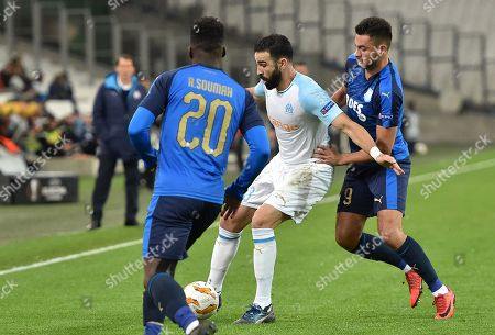 Adil Rami (C) of Olympique Marseille and David Faupala (R) of Apollon Limassol in action during UEFA Europa League group H soccer match between Olympique Marseille and Apollon Limassol at the Velodrome Stadium in Marseille, southern France, 28 October 2018.