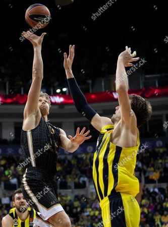 Armani Exchange Milan's Mindaugas Kuzminskas (L) in action against Fenerbahce's jan Vesely (R) at the Euroleague basketball match between Fenerbahce and Armani Exchange Milan in Istanbul, Turkey 13 December 2018.
