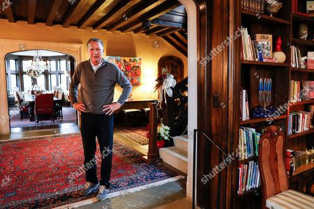 Ohio Gov. John Kasich stands in the foyer after an interview with The Associated Press at the Ohio Governor's Residence and Heritage Garden, in Columbus