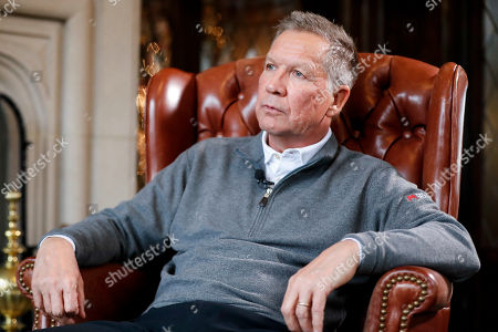 Ohio Gov. John Kasich sits for an interview with The Associated Press at the Ohio Governor's Residence and Heritage Garden, in Columbus