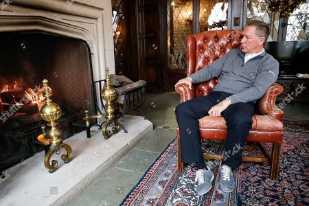 Ohio Gov. John Kasich sits by a fireplace after an interview with The Associated Press at the Ohio Governor's Residence and Heritage Garden, in Columbus