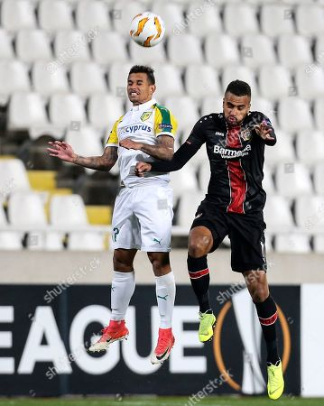 Leverkusen's Isaac Kiese Thelin, right, and Larnaca's Igor Silva challenge for the ball during the Europa League group A soccer match between AEK Larnaca and Bayer Leverkusen at GSP stadium in Nicosia, Cyprus, on