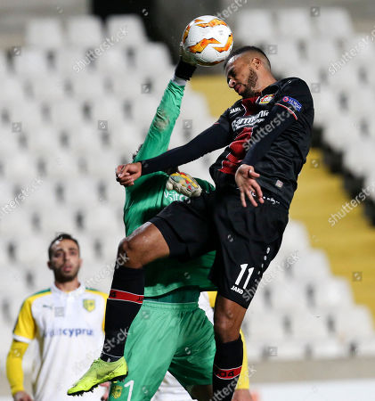 Larnaca's goalkeeper Andreas Christodoulou and Leverkusen's Isaac Kiese Thelin challenge for the ball during the Europa League group A soccer match between AEK Larnaca and Bayer Leverkusen at GSP stadium in Nicosia, Cyprus, on