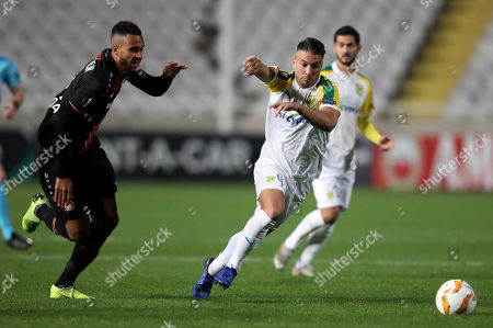 David Catala (R) of AEK Larnaca in action against Isaac Kiese Thelin (L) of Leverkusen during the UEFA Europa League Group A soccer match between AEK Larnaca and Leverkusen FC at the GSP stadium in Nicosia, Cyprus, 13 December 2018.