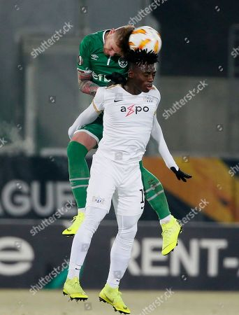 FC Zurich's Stephen Odey vies for the ball with Ludogorets' Jacek Goralski during Europa League group A match between PFC Ludogorets Razgrad and FC Zurich at Ludogorets Arena in Razgrad, Bulgaria, on