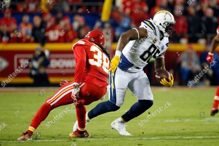 Los Angeles Chargers tight end Antonio Gates (85) runs away from Kansas City Chiefs safety Ron Parker (38) during the first half of an NFL football game in Kansas City, Mo