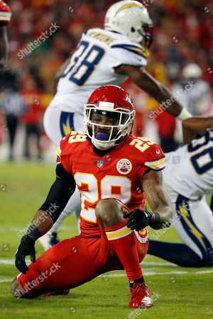 Kansas City Chiefs defensive back Eric Berry (29) gets up after tackling Los Angeles Chargers tight end Virgil Green (88) during the first half of an NFL football game in Kansas City, Mo