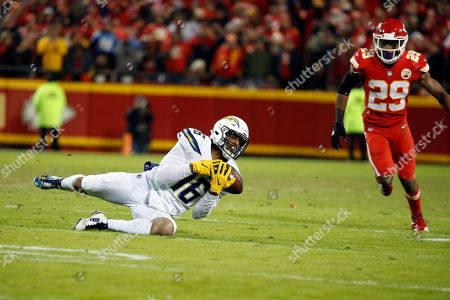 Los Angeles Chargers wide receiver Tyrell Williams (16) makes a catch as Kansas City Chiefs defensive back Eric Berry (29) closes in, during the first half of an NFL football game against the Kansas City Chiefs in Kansas City, Mo