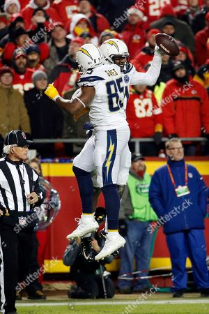 Los Angeles Chargers wide receiver Mike Williams, rear, celebrates his touchdown with tight end Antonio Gates (85) during the second half of an NFL football game against the Kansas City Chiefs in Kansas City, Mo., . The Los Angeles Chargers won 29-28