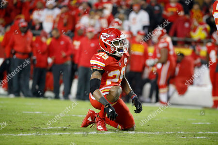 Kansas City Chiefs defensive back Eric Berry (29) looks up after tying his shoe laces during the first half of an NFL football game against the Los Angeles Chargers in Kansas City, Mo