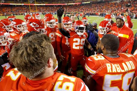 Kansas City Chiefs defensive back Eric Berry (29) talks to teammates before an NFL football game against the Los Angeles Chargers, in Kansas City, Mo. The Chargers won 29-28