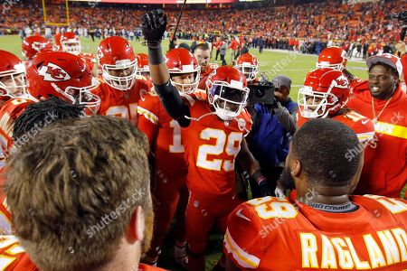 Patrick Mahomes, Eric Berry. Kansas City Chiefs players gather around defensive back Eric Berry (29) and quarterback Patrick Mahomes (15) before an NFL football game against the Los Angeles Chargers in Kansas City, Mo