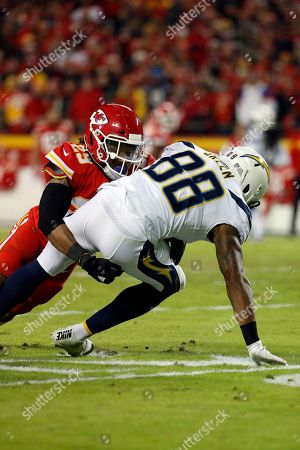 Eric Berry, Virgil Green. Kansas City Chiefs defensive back Eric Berry (29) tackles Los Angeles Chargers tight end Virgil Green (88) during the first half of an NFL football game in Kansas City, Mo