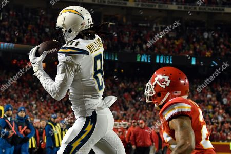Mike Williams, Orlando Scandrick. Los Angeles Chargers wide receiver Mike Williams (81) makes a touchdown catch in front of Kansas City Chiefs defensive back Orlando Scandrick (22) during the second half of an NFL football game in Kansas City, Mo., . The Los Angeles Chargers won 29-28
