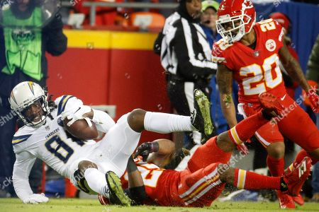 Eric Berry, Mike Williams. Los Angeles Chargers wide receiver Mike Williams (81) scores a touchdown against Kansas City Chiefs defensive back Eric Berry (29) during the first half of an NFL football game in Kansas City, Mo
