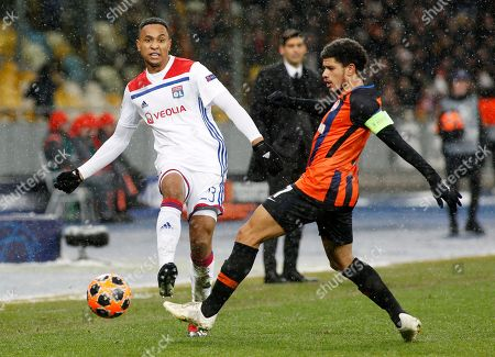 Kenny Tete (L) of Lyon and Taison (R) of Shakhtar are seen in action during the UEFA Champions League Group F football match between Shakhtar Donetsk and Lyon at the NSK Olimpiyskyi in Kiev.  (Final score; Shakhtar Donetsk 1:1 Lyon)