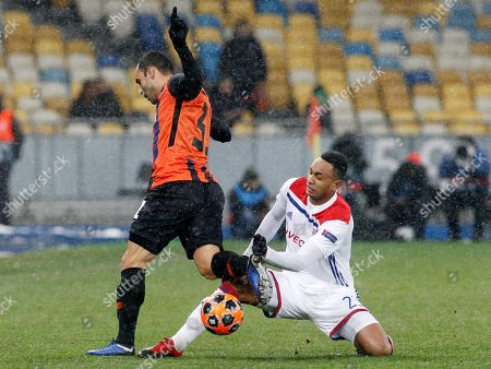 Kenny Tete (R) of Lyon and Taison (L) of Shakhtar are seen in action during the UEFA Champions League Group F football match between Shakhtar Donetsk and Lyon at the NSK Olimpiyskyi in Kiev.  (Final score; Shakhtar Donetsk 1:1 Lyon)