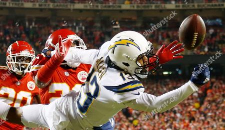 Los Angeles Chargers wide receiver Keenan Allen (R) drops a pass in the end zone while covered by Kansas City Chiefs safety Eric Berry (C) in the first half of the NFL American football game at between the Los Angeles Chargers and the Kansas City Chiefs at Arrowhead Stadium in Kansas City, Missouri, USA, 13 December 2018.