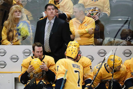 Nashville Predators head coach Peter Laviolette looks up at the scoreboard in the third period of an NHL hockey game between the Predators and the Vancouver Canucks, in Nashville, Tenn