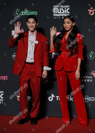 Bae Jung-nam, Moon Gabi. South Korean model-actor Bae Jung-nam, left, and model Moon Gabi pose for photos on the red carpet of the Mnet Asian Music Awards (MAMA) in Hong Kong