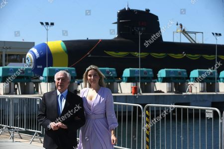 The President of Brazil Michel Temer (L) and the First Lady Marcela Temer (R), pose next to the submarine Riachuelo, in the port of Itaguai, Rio de Janeiro, Brazil, 14 December 2018. The Brazilian Navy launched the Riachuelo, the first of the five submarines it is building in the country in the framework of a military cooperation agreement with France and which foresees the development of a nuclear-powered submersible.