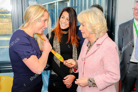 Camilla Duchess of Cornwall meets Olympic gold medalist Stephanie Millward during a visit to Wiltshire Air Ambulance's airbase at Outmarsh