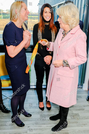 Stock Photo of Camilla Duchess of Cornwall meets Paralympic gold medalist Stephanie Millward during a visit to Wiltshire Air Ambulance's airbase at Outmarsh
