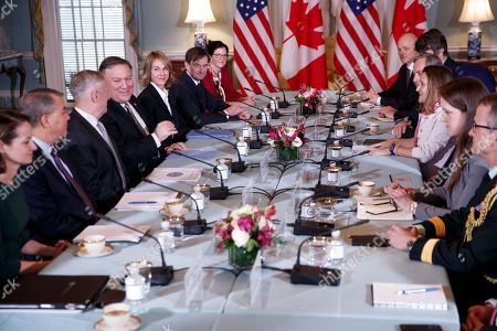 US Secretary of State Mike Pompeo (4-L) Secretary of Defense James Mattis (3-L), Canadian Foreign Minister Chrystia Freeland (3-R) and Canadian Defense Minister Harjit Sajjan (out of frame) participate in the US-Canada 2+2 Ministerial at the State Department in Washington, DC, USA, 14 December 2018. US Secretary of State Mike Pompeo and Secretary of Defense James Mattis host the US-Canada 2+2 Ministerial with Canadian Foreign Minister Chrystia Freeland, and Canadian Defense Minister Harjit Sajjan at the Department of State.