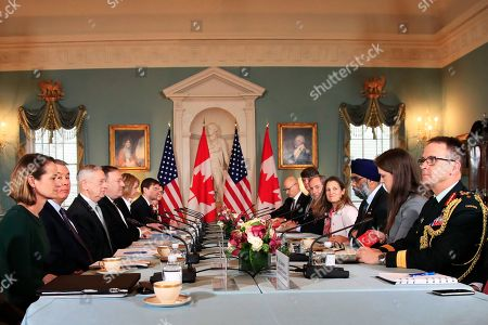 Mike Pompeo, Jim Mattis, Chrystia Freeland, Harjit Sajjan. Secretary of State Mike Pompeo, fourth from left, and Defense Secretary Jim Mattis, third from left, meet their Canadian counterparts Canadian Minister of Foreign Affairs Chrystia Freeland, forth from right, and Canadian Minister of Defense Harjit Sajjan, third from right, during the U.S.-Canada 2+2 Ministerial at the State Department in Washington
