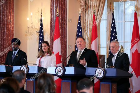 Mike Pompeo, Jim Mattis, Chrystia Freeland, Harjit Sajjan. Secretary of State Mike Pompeo, second from right, with Defense Secretary Jim Mattis, right, and their Canadian counterparts Canadian Minister of Foreign Affairs Chrystia Freeland and Canadian Minister of Defense Harjit Sajjan, left, speaks to reporters during a news conference following meeting at the State Department in Washington