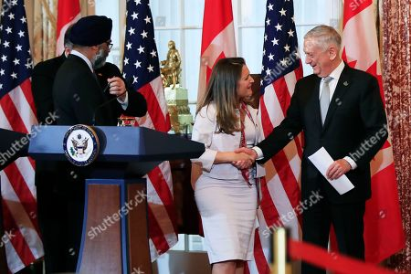 Mike Pompeo, Jim Mattis, Chrystia Freeland, Harjit Sajjan. Secretary of State Mike Pompeo, back left, and Defense Secretary Jim Mattis right, shake hands with their Canadian counterparts Canadian Minister of Foreign Affairs Chrystia Freeland, second from right, and Canadian Minister of Defense Harjit Sajjan, left, as they conclude their news conference following a U.S.-Canada 2+2 Ministerial at the State Department in Washington