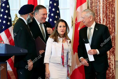 Mike Pompeo, Jim Mattis, Chrystia Freeland, Harjit Sajjan. Secretary of State Mike Pompeo, second from left, and Defense Secretary Jim Mattis right, and their Canadian counterparts Canadian Minister of Foreign Affairs Chrystia Freeland, second from right, and Canadian Minister of Defense Harjit Sajjan, left, leave the Benjamin Franklin Room as they conclude their news conference following a U.S.-Canada 2+2 Ministerial at the State Department in Washington