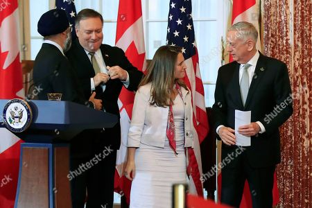 Mike Pompeo, Jim Mattis, Chrystia Freeland, Harjit Sajjan. Secretary of State Mike Pompeo, second from left, and Defense Secretary Jim Mattis right, shake hands with their Canadian counterparts Canadian Minister of Foreign Affairs Chrystia Freeland, second from right, and Canadian Minister of Defense Harjit Sajjan, left, as they conclude their news conference following a U.S.-Canada 2+2 Ministerial at the State Department in Washington