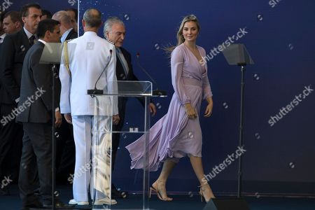 Marcela Temer, Michel Temer. Brazil's first lady Marcela Temer and her husband President Michel Temer arrive for a ceremonial launch party of the new submarine Riachuelo at the Itaguai Naval Complex in Itaguai, Brazil