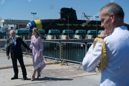 Michel Temer, Marcela Temer. Brazil's President Michel Temer and his wife Marcela pose for a photo backdropped by the new submarine Riachuelo, during a ceremonial launch party, at the Itaguai Naval Complex in Itaguai, Brazil, . This is the first of five submarines built with French technology