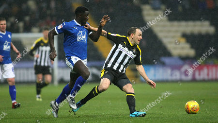 David Vaughan holds off Tranmere's Zoumana Bakayogo
